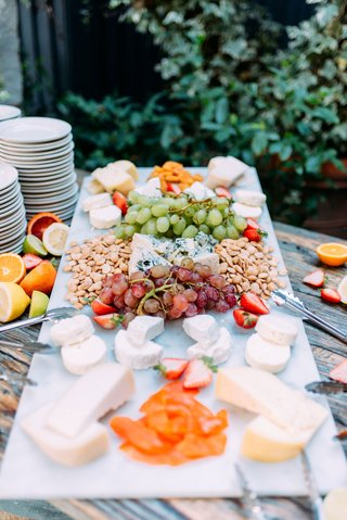 wedding-reception-cheese-plate-charcuterie-display-grapes-nuts-cheese-strawberries