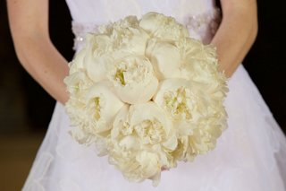 bride-in-white-vera-wang-wedding-dress-holding-ivory-bouquet-of-all-white-peony-flowers