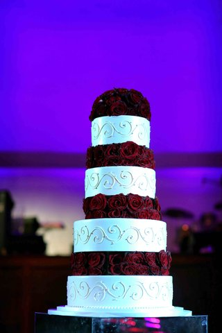 white-round-cake-with-scroll-motif-and-roses