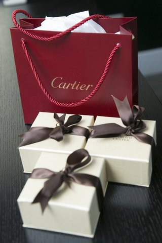 red-cartier-bag-three-ivory-boxes-with-brown-ribbon-bows-at-wedding