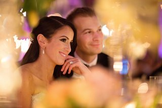 bride-and-groom-smiling-at-sweetheart-table