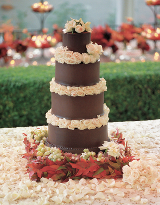 five-layer-chocolate-cake-with-ivory-flower-decorations