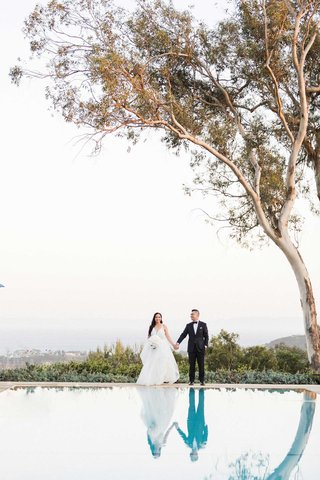 santa-barbara-belmond-el-encanto-wedding-portrait-bride-hayley-paige-groom-tuxedo-by-pool