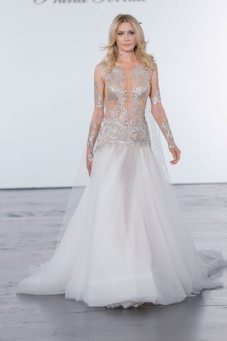 pnina-tornai-for-kleinfeld-2018-wedding-dress-drop-waist-sheer-bodice-long-sleeves-silver-embroidery