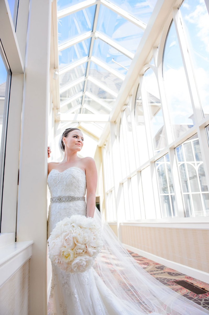 Bride Looking Up at Skylight