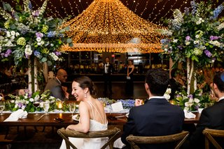 A Charming Fete Couple Laughing during toasts sweetheart table