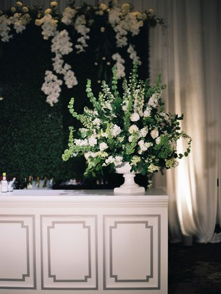 A Charming Fete Wedding Bar Décor greenery white flower arrangement