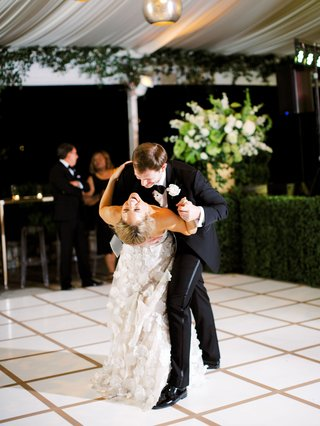bride in mira zwillinger wedding dress bustle dip happy smile couple dance floor