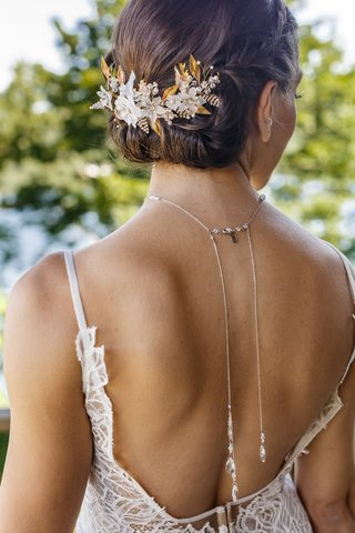 bridal-headpiece-with-gold-leaves-and-white-flowers-on-bridal-updo-back-necklace