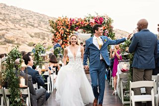 wedding-ceremony-recessional-bride-groom-outdoor-ceremony-hummingbird-nest-ranch-colorful-decor