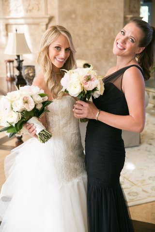 bride-in-bridal-suite-with-girlfriend-in-asymmetrical-dress