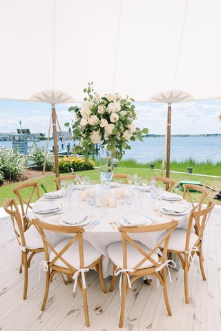 backyard-tented-wedding-reception-vineyard-chairs-centerpiece-with-roses-and-eucalyptus-leaves