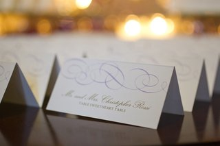 wedding-escort-cards-with-a-light-purple-wavy-pattern