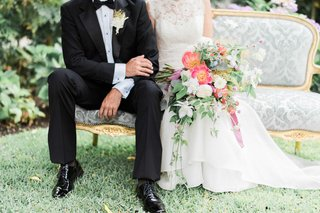 groom-in-tuxedo-and-dress-shoes-with-rustic-boutonniere-bride-in-jinza-bridal-couture-with-bouquet