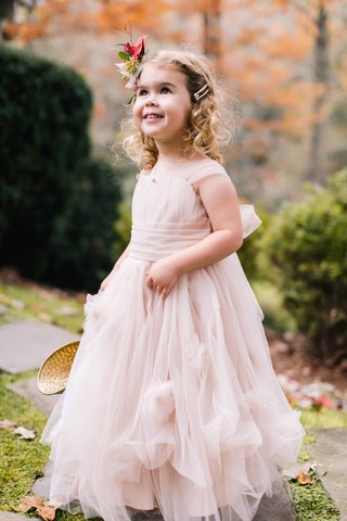 adorable-flower-girl-in-flowing-pink-princess-dress-with-ribbon-sash-and-floral-headband