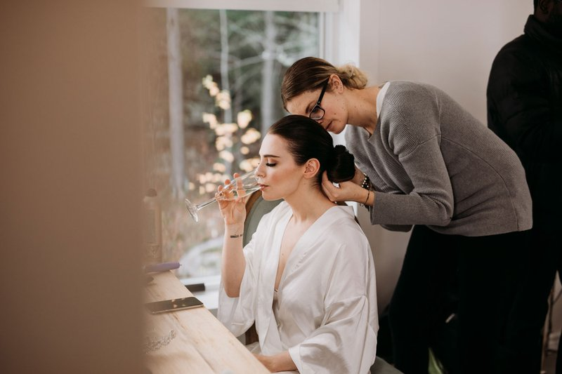 Bride Sipping Champagne While Getting Ready
