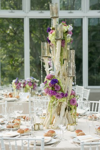 wooden-centerpiece-with-purple-flowers-crystals-and-mercury-glass