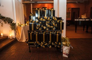 black-boxes-with-gold-ribbons-holding-wedding-favors-train-bassist-hector-maldonado-wedding