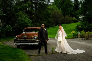 bride-in-eddy-k-lace-wedding-dress-blush-overskirt-groom-in-all-black-edgy-wedding-portraits