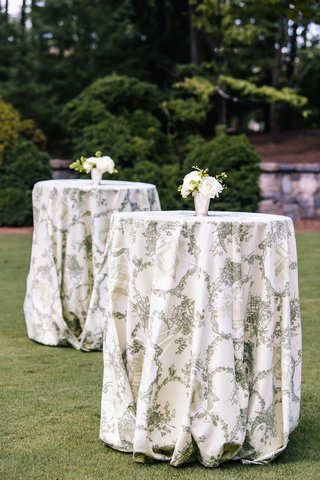 tall-cocktail-tables-on-grass-lawn-with-white-and-green-southern-pattern-and-small-white-flowers