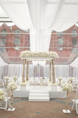 winter-wedding-ceremony-with-birch-tree-design-details-and-all-white-flowers-and-drapery