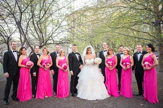 bride-in-layered-alyne-ball-gown-bridesmaids-in-one-shoulder-hot-pink-gowns-from-davids-bridal
