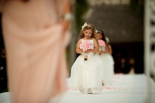 flower-girls-in-white-dresses-walking-down-aisle