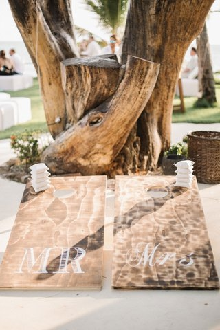 wedding-games-lawn-wood-cornhold-board-with-white-bean-bags-mr-and-mrs-boards-by-tree-destination