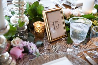 a-simple-tablescape-inspired-secret-garden-with-leafy-table-runner-and-gold-frame-table-number
