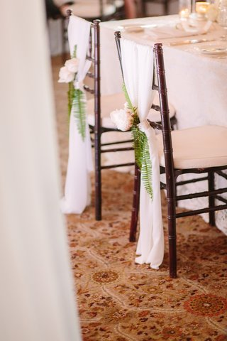 bride-and-groom-seat-marker-all-white-decor-flowers-on-bride-and-grooms-chairs