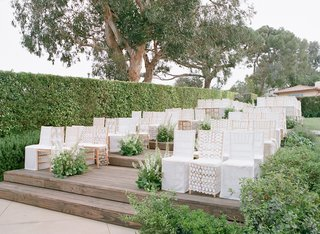 outdoor-ceremony-on-wood-deck-with-white-lace-chair-covers