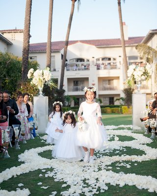 flower-girls-in-flower-crowns-walking-down-aisle-flower-petal-aisleway-swirl-design-resort-wedding