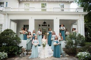 bride-in-mermaid-lace-gown-bridesmaids-in-teal-blue-and-sea-green-convertible-dresses
