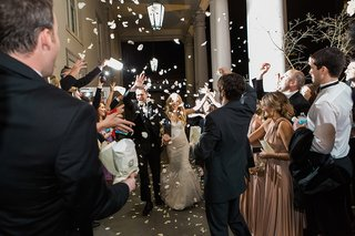 throwing-flower-petals-at-the-newlyweds-during-their-wedding-getaway-grand-exit