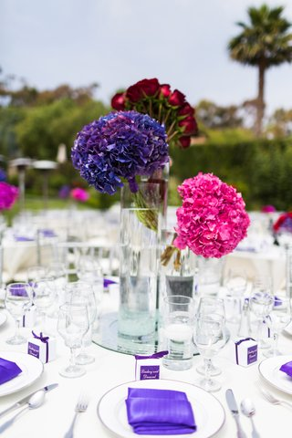 bundles-of-pink-purple-and-red-flowers-in-varying-height-vases