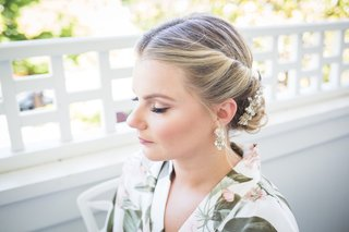 bride-with-natural-bridal-makeup-and-eyeliner-blonde-hair-twisted-into-low-updo