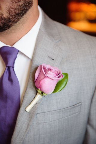 groom-in-a-grey-suit-purple-tie-and-light-purple-rose-boutonniere