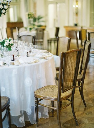 wedding-reception-lake-como-villa-white-round-table-linen-cane-back-chairs-wood-floors