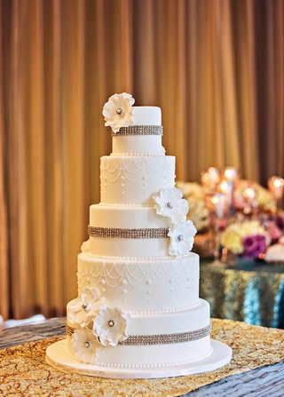 five-layer-white-wedding-cake-with-rhinestones-and-flowers