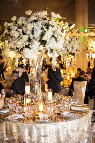 wedding-reception-shimmering-linens-ghost-chairs-roses-hydrangeas-greenery
