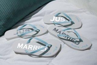 wedding-gift-and-favor-ideas-white-flip-flops-betsey-johnson-white-flip-flops-just-married-light-blu