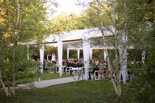 white-clear-top-wedding-tent-in-backyard-illinois-outdoor-wedding-ceremony