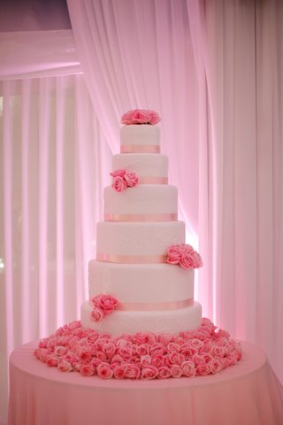 tall-white-cake-with-pink-ribbon-and-pink-roses