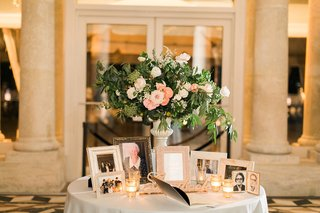 wedding-reception-small-table-flower-arrangement-frames-of-late-loved-ones-deceased-family-members