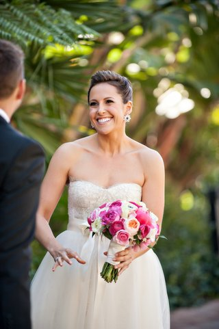 bride-in-monique-lhuillier-wedding-dress-with-pink-bouquet
