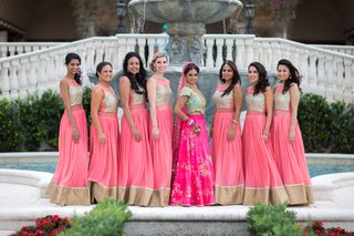 indian-american-bride-in-pink-and-turquoise-lehenga-bridesmaids-in-traditional-outfit-in-pink-tan