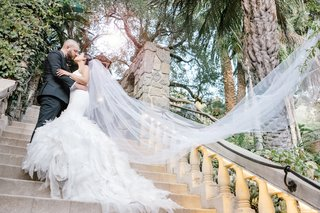 two-tier-cathedral-veil-blowing-behind-ride-veil-shot-wedding-inspiration-photos-bridal-veil-photo