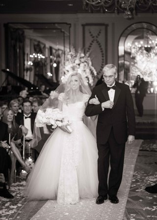 black-and-white-photo-of-father-walking-daughter-the-bride-down-the-aisle