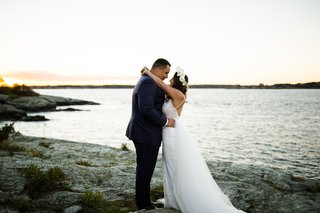 groom-navy-suit-bride-dress-flower-crown-newport-rhode-island-ocean-shoreline-berta-bridal-desinger