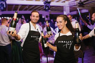 servers-wearing-finally-fay-personalized-aprons-moet-champagne-sparklers-purple-lighting-dance-floor